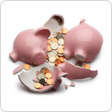 Broken piggy bank with cash spilling out
